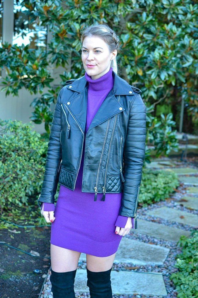 black moto jacket and purple sweater