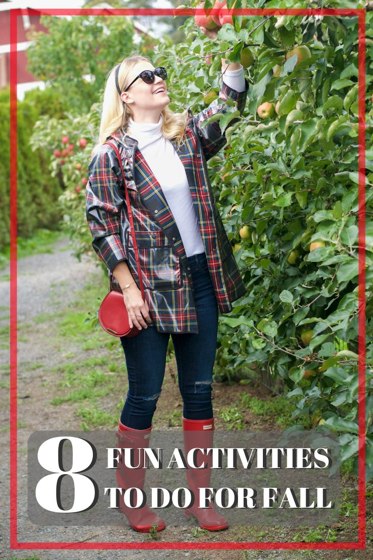 zara plaid raincoat hunter boots | Fall Activities by popular Seattle lifestyle blog, Whit Wanders: image of a woman in a apple orchard and wearing a Zara plaid rubberized rain coat, white turtle neck, jeans, and red Hunter rain boots.