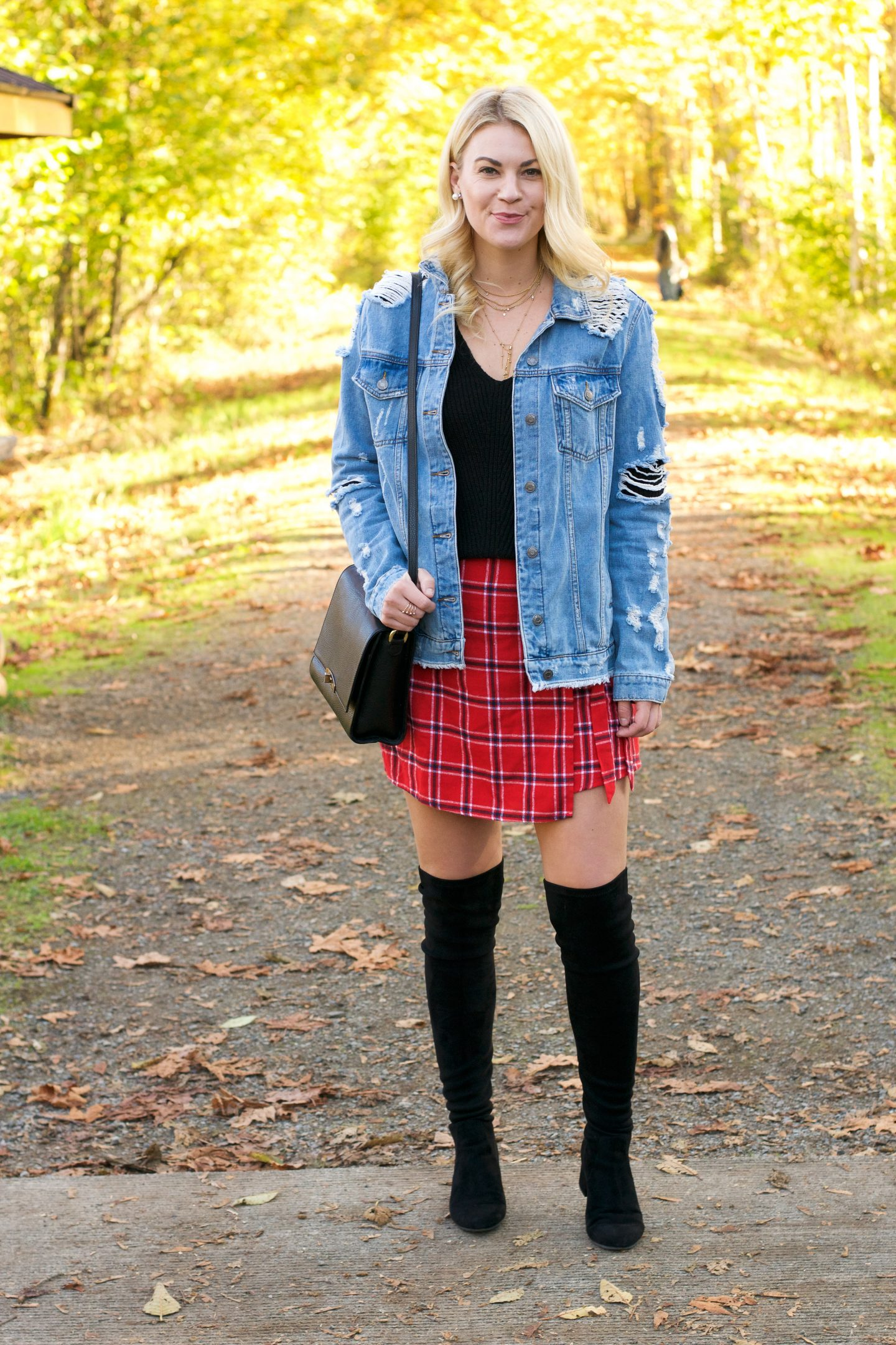 Oversized Jacket by popular Seattle tall fashion blog, Whit Wanders: image of a woman wearing a Nasty Gal Rough and Ready Distressed Denim Jacket, plaid skirt, and over the knee boots.