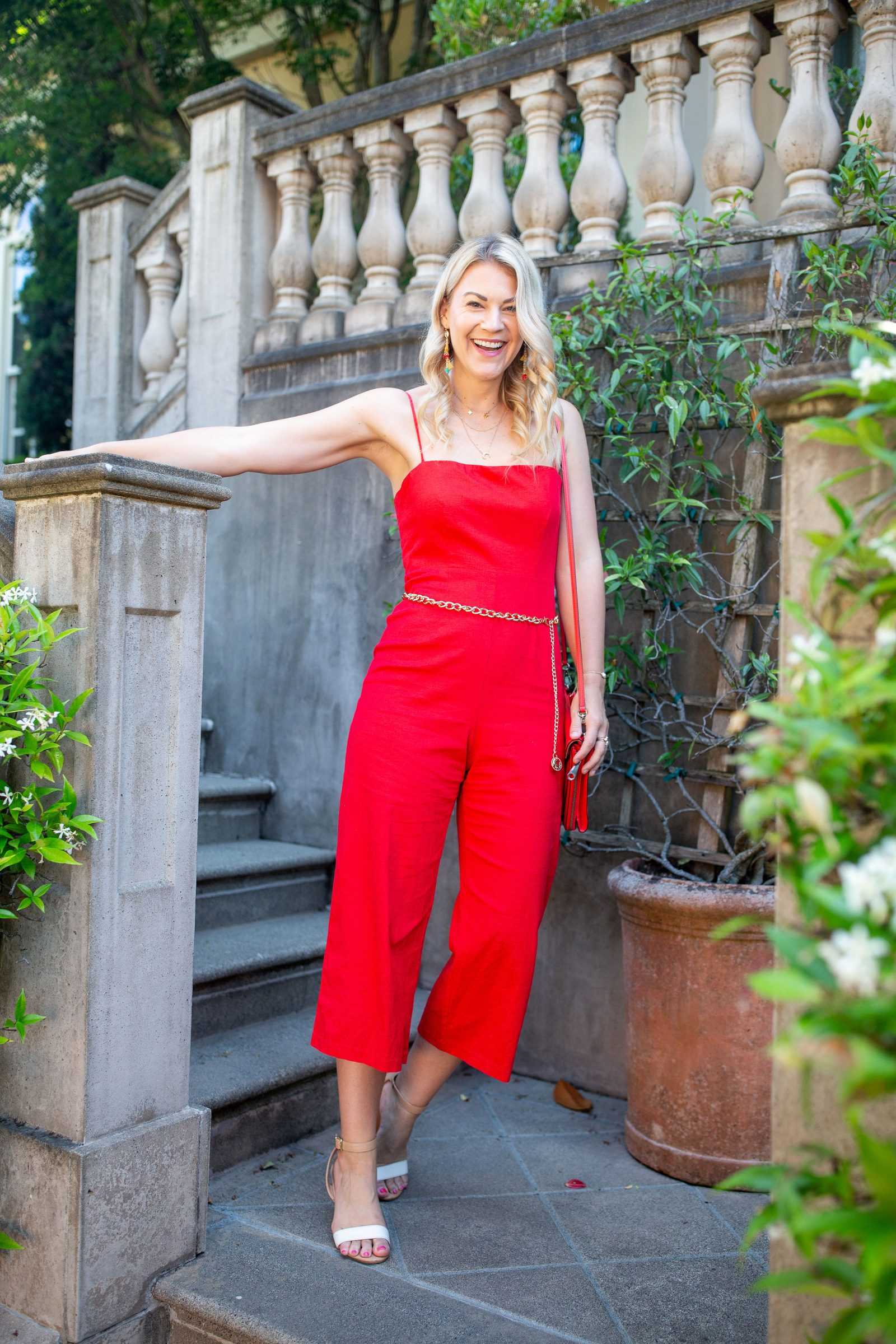 Red Tall Girl Jumpsuit styled by top Seattle tall fashion blogger, Whit Wanders: image of a blonde woman wearing an ASTR the Label red jumpsuit