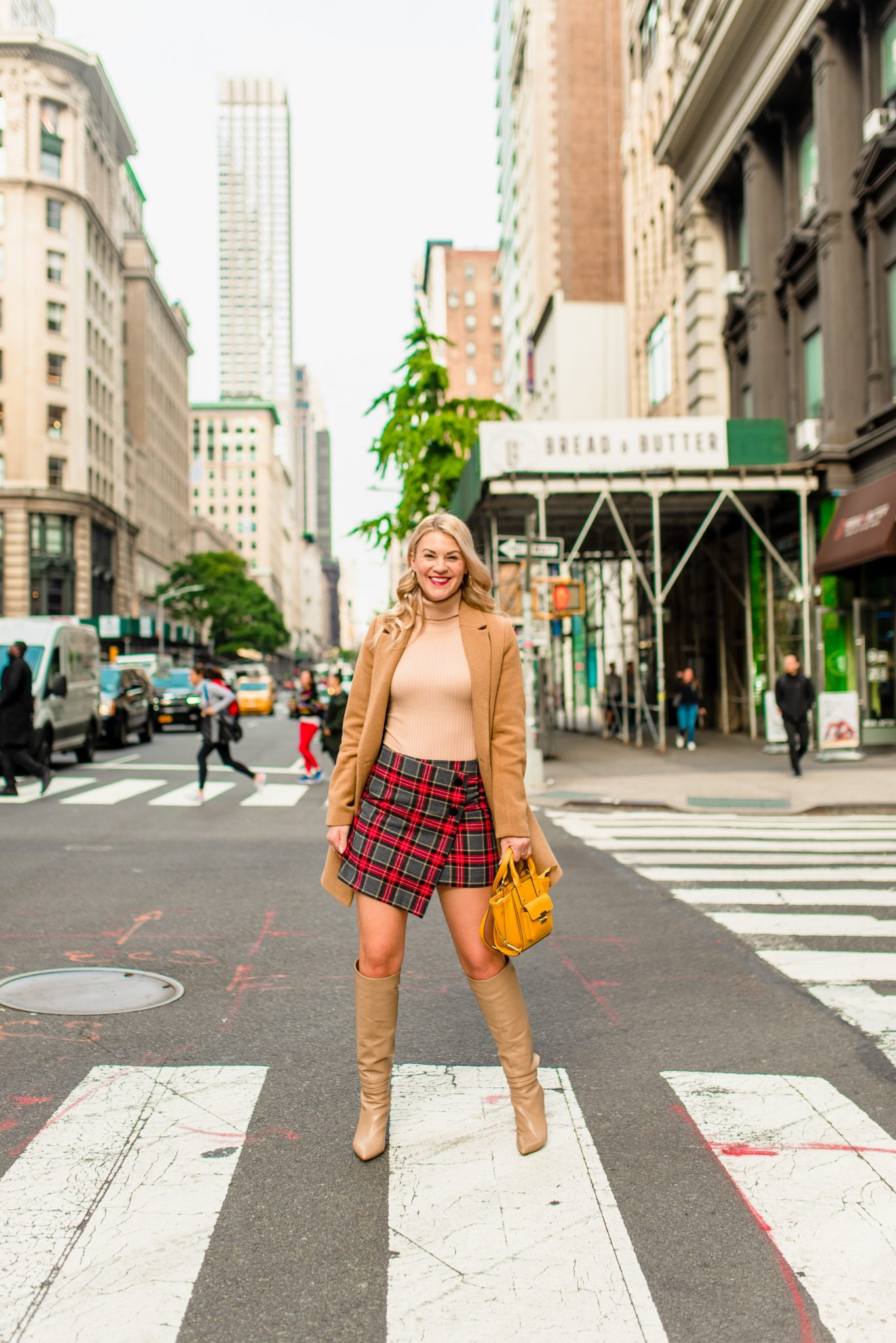 Slouchy Boots by popular Seattle tall fashion blog, Whit Wanders: image of a woman walking outside in Downtown Seattle and wearing a Nordstrom Coat, Forever21 Top, H&M Skirt, Vince Camuto Boots while carrying a Jason Wu tote via Target.