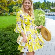20 Cheap Summer Floral Dresses Under $50 featured by top Seattle fashion blogger, Whit Wanders: image of a blonde woman wearing an Eliza J yellow floral dress.