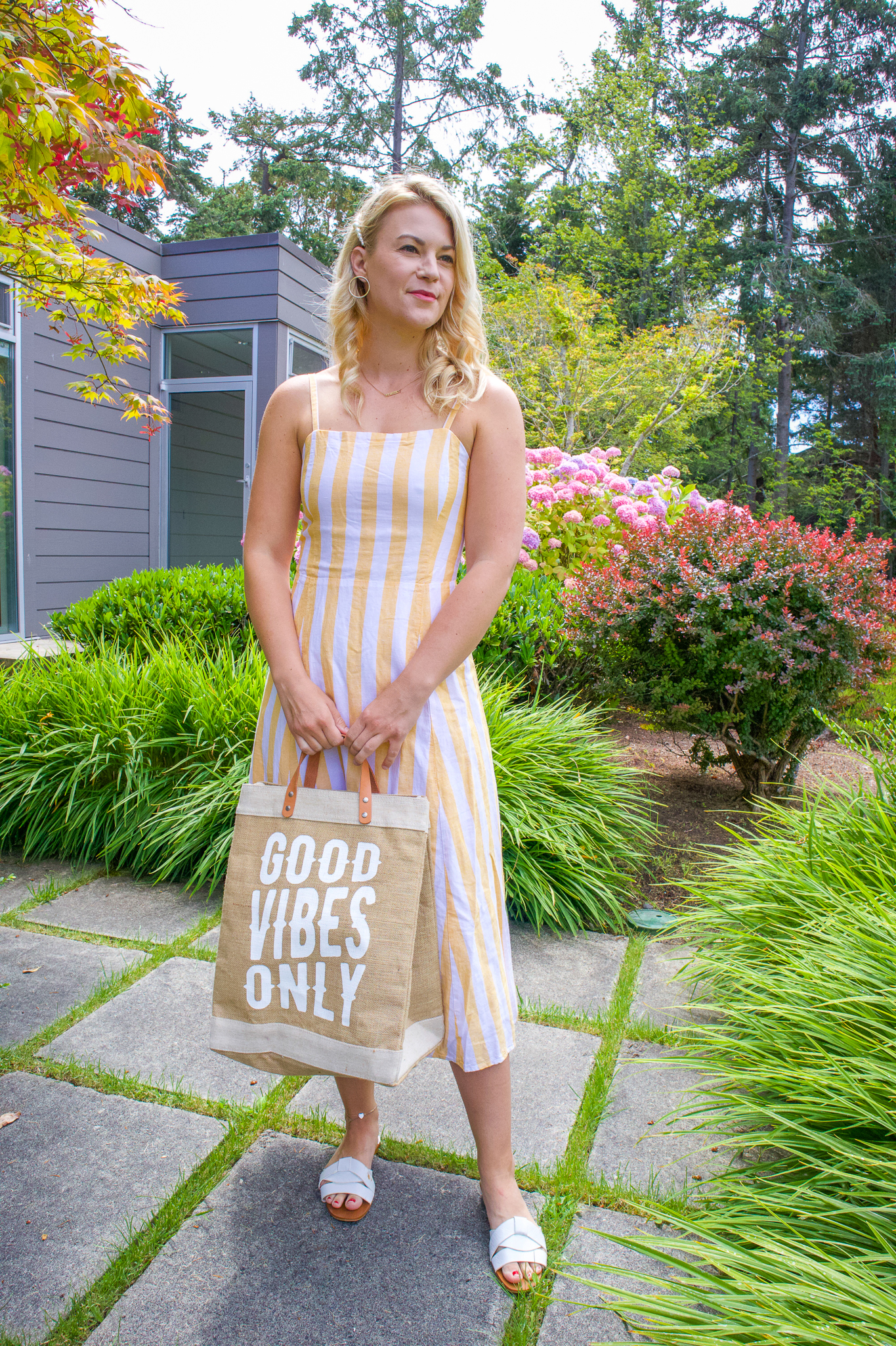 Summer Striped Midi Dresses Under $50  featured by top US Seattle fashion blogger, Whit Wanders: image of a woman wearing a GAP striped midi dress
