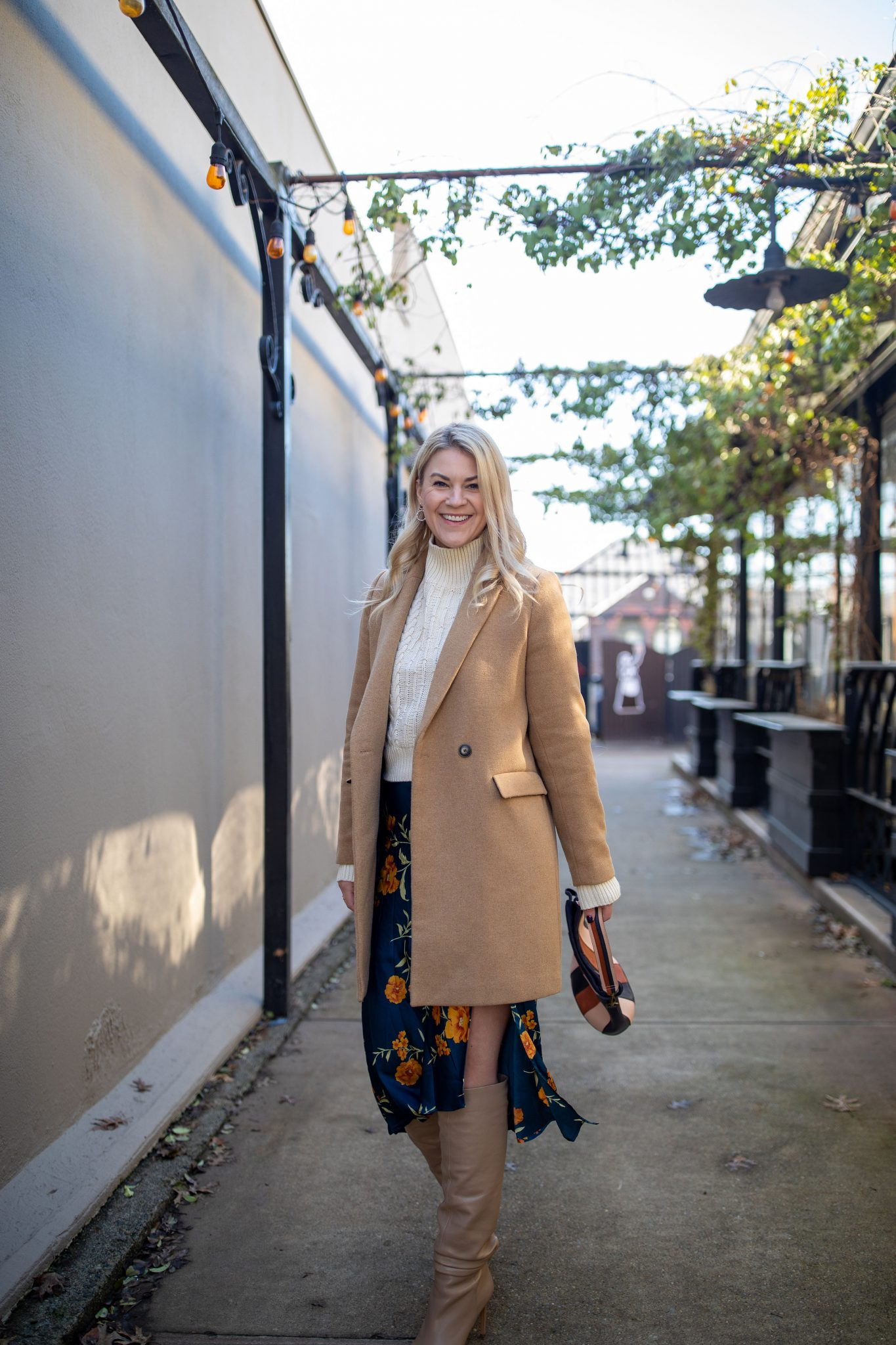 Slip Dress by popular Seattle tall fashion blog, Whit Wanders: image of a woman wearing a Zara camel coat, TopShop cable-knit turtleneck, Astr the Label slip dress, Vince Camuto OTK Boots, and carrying a Madewell purse.