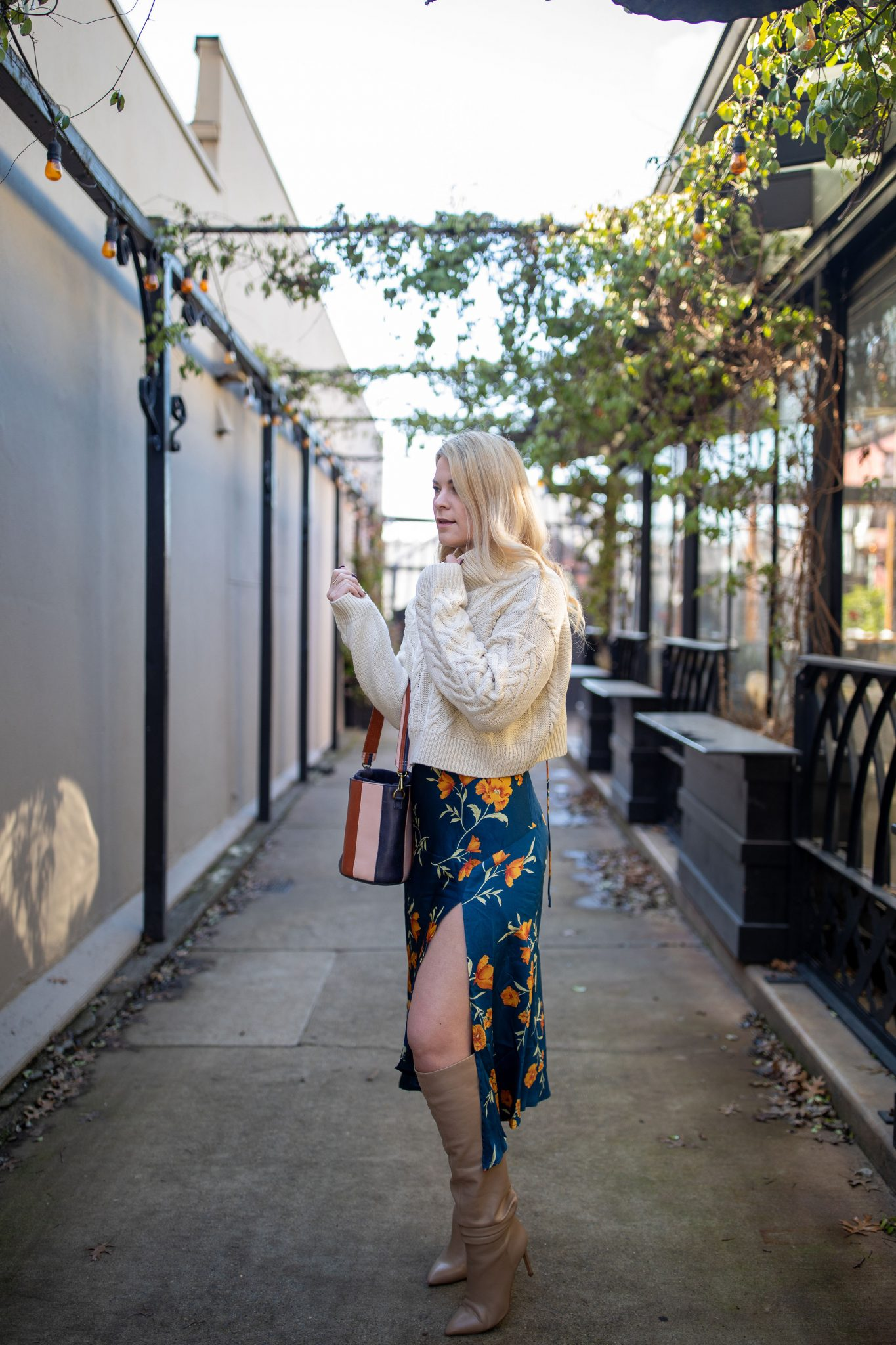 Slip Dress by popular Seattle tall fashion blog, Whit Wanders: image of a woman wearing a TopShop cable-knit turtleneck, Astr the Label slip dress, Vince Camuto OTK Boots, and carrying a Madewell purse.