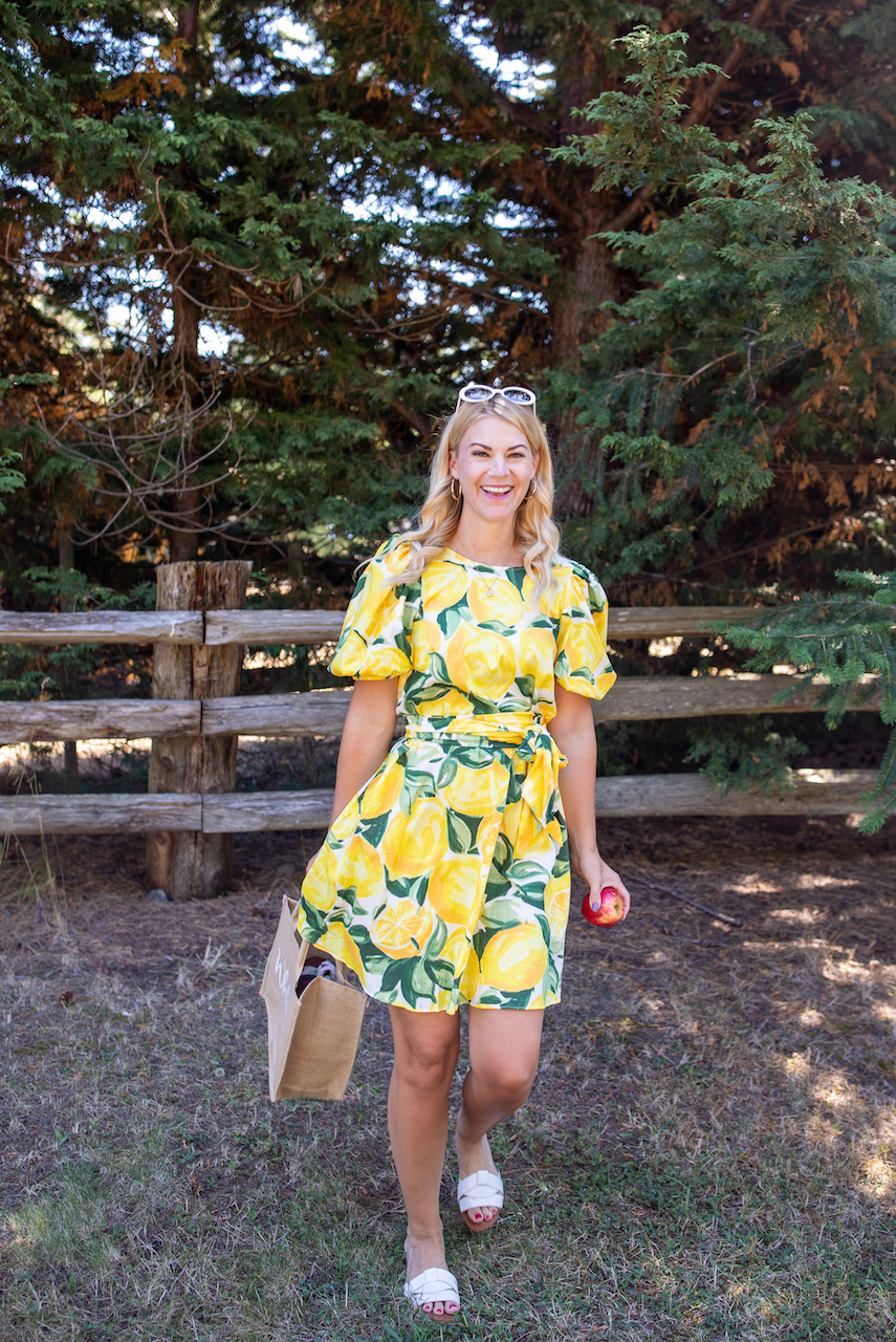 H&M Plus Size by popular Seattle tall fashion blog, Whit Wanders: image of a woman standing outside and wearing a H&M Lyocell-blend Dress and white slide sandals.