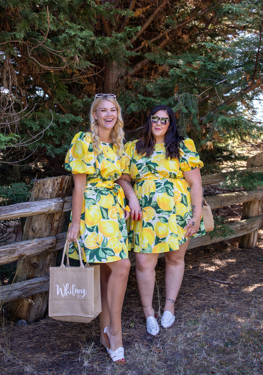 H&M Plus Size by popular Seattle tall fashion blog, Whit Wanders: image of two women standing outside and wearing a H&M Lyocell-blend Dress, white slide sandals, and white slide mules.