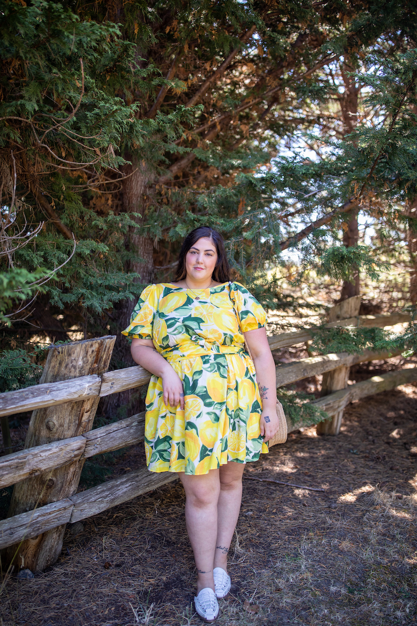 H&M Plus Size by popular Seattle tall fashion blog, Whit Wanders: image of a woman standing outside and wearing a H&M Lyocell-blend Dress and white slide mules.