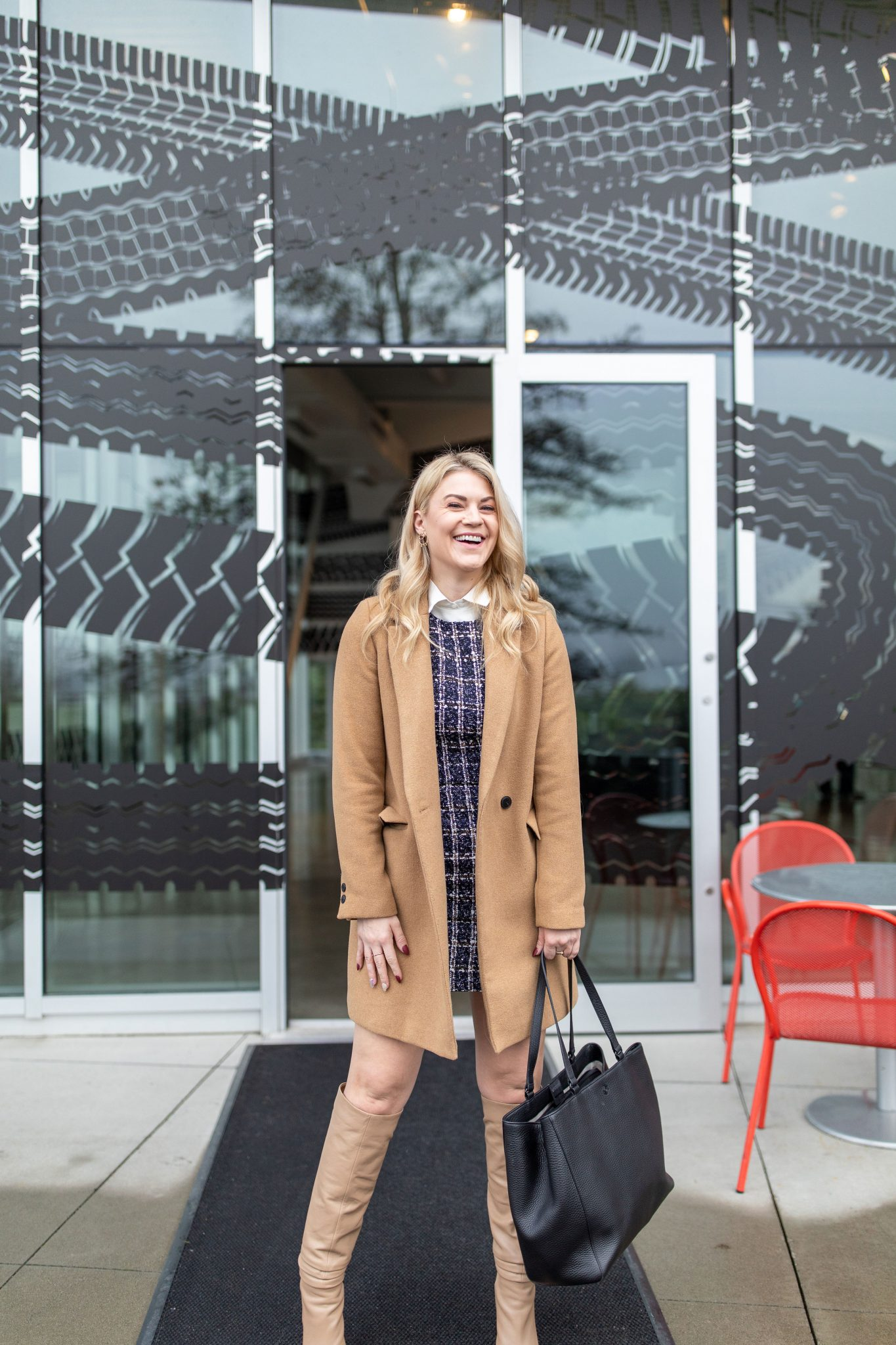 New Job by popular Seattle lifestyle blog, Whit Wanders: image of a woman wearing a tweed dress, tan wool coat, tan knee high boots, and carrying a black leather bag.
