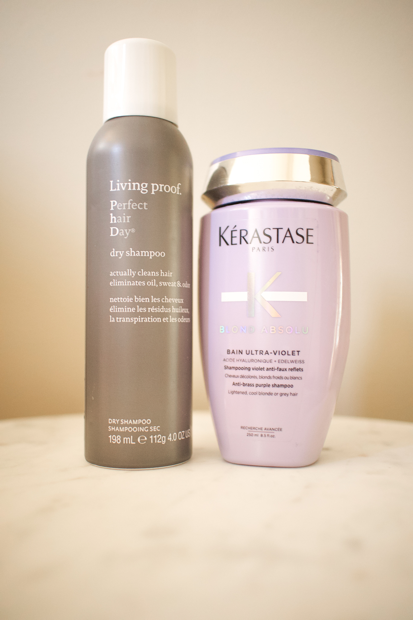 Empties by popular Seattle beauty blog, Whit Wanders: image of Kerastase satin ultra violet shampoo and Living Proof dry shampoo.