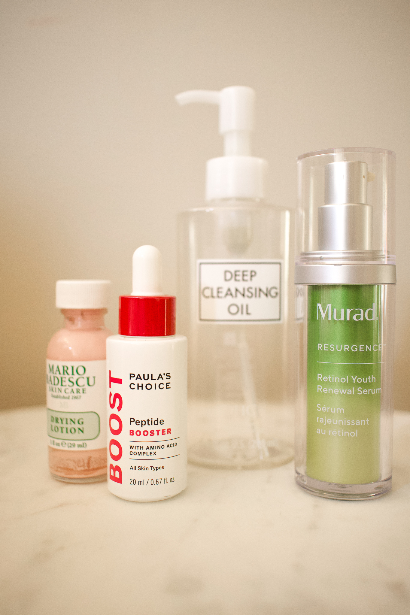 Empties by popular Seattle beauty blog, Whit Wanders: image of Paula's Choice peptide booster, Deep cleansing oil, Murad Resurgence, and Mario Badescu drying lotion.
