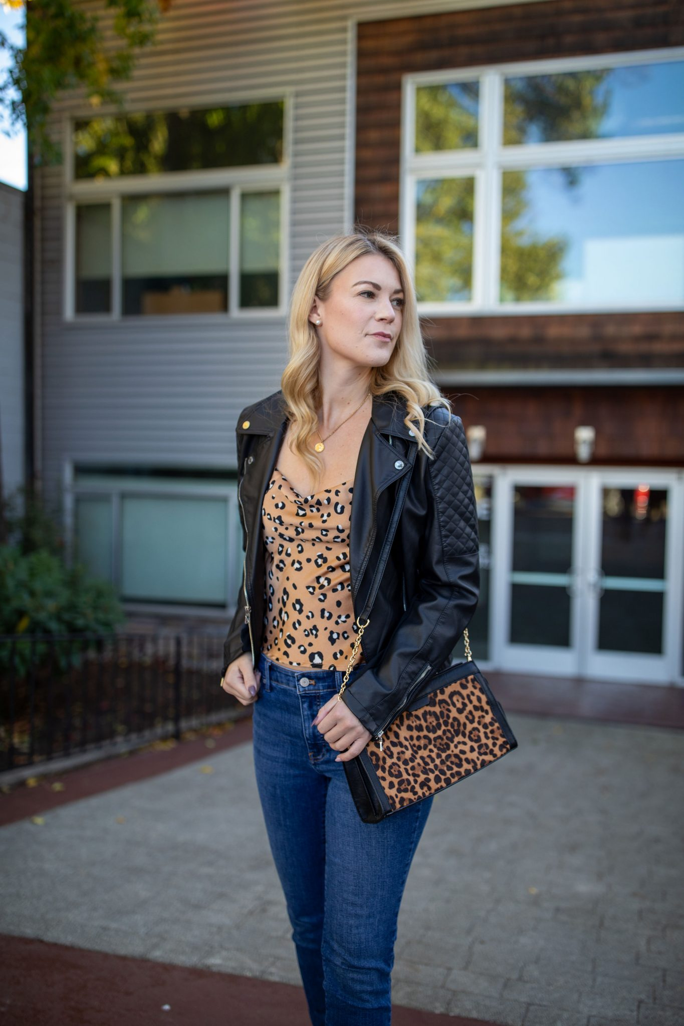 Leather Jacket by popular Seattle tall fashion blog, Whit Wanders: image of a woman wearing a Express Leather Jacket, Nastygal cami, Madewell jeans, Ralph Lauren Black Booties, and holding a Sole Society Purse.