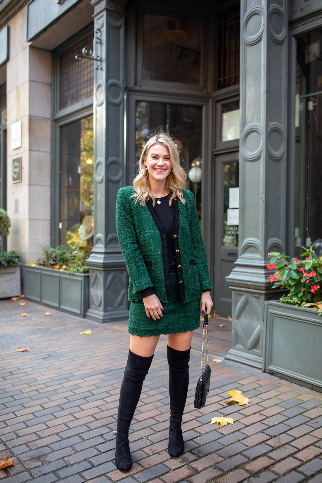 Tweed Suit by popular Seattle tall fashion blog, Whit Wanders: image of a woman standing outside and wearing a Zara green tweed suit and black over the knee boots.