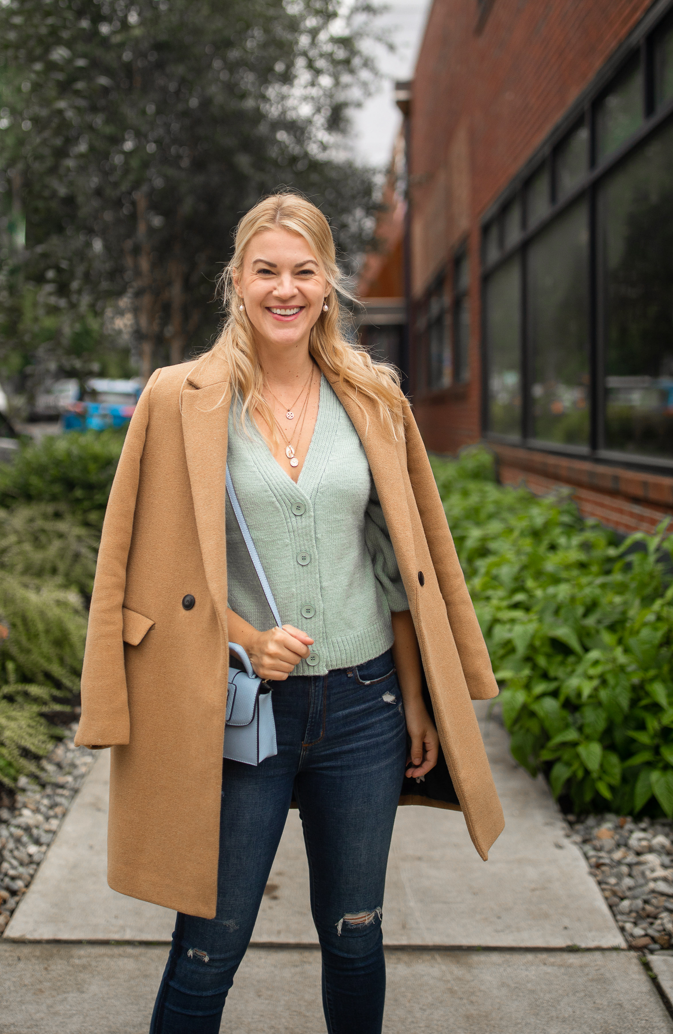 Knit Cardigan by popular Seattle tall fashion blog, Whit Wanders: image of a woman wearing a green H&M knit cardigan, camel color wool coat, and distressed jeans.