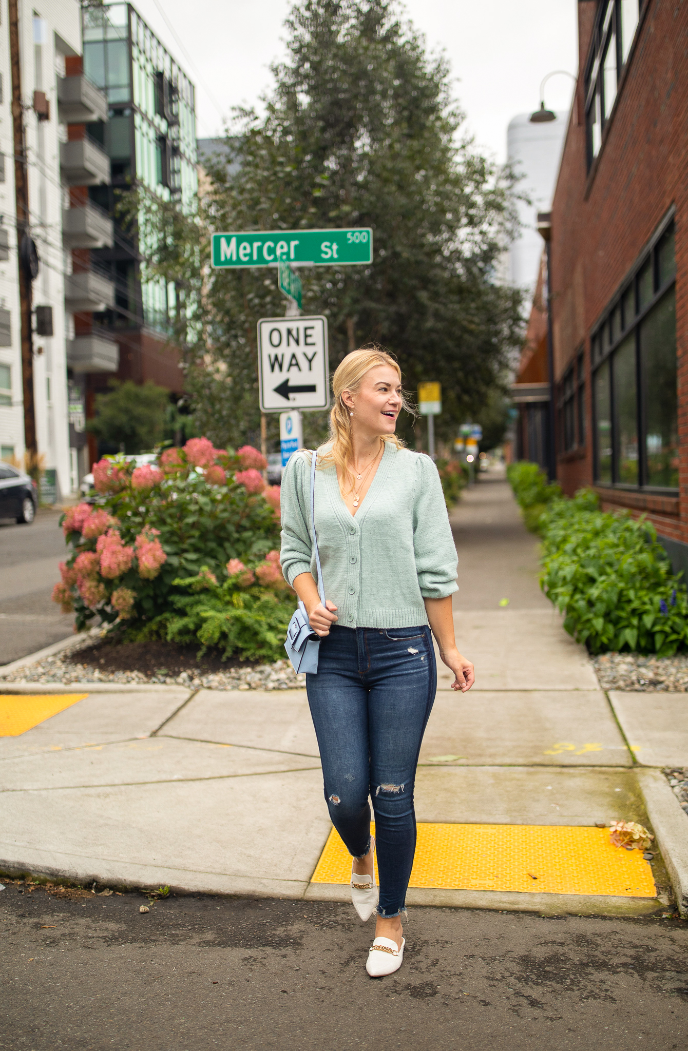 Knit Cardigan by popular Seattle tall fashion blog, Whit Wanders: image of a woman wearing a green H&M knit cardigan, white loafers, and distressed jeans.