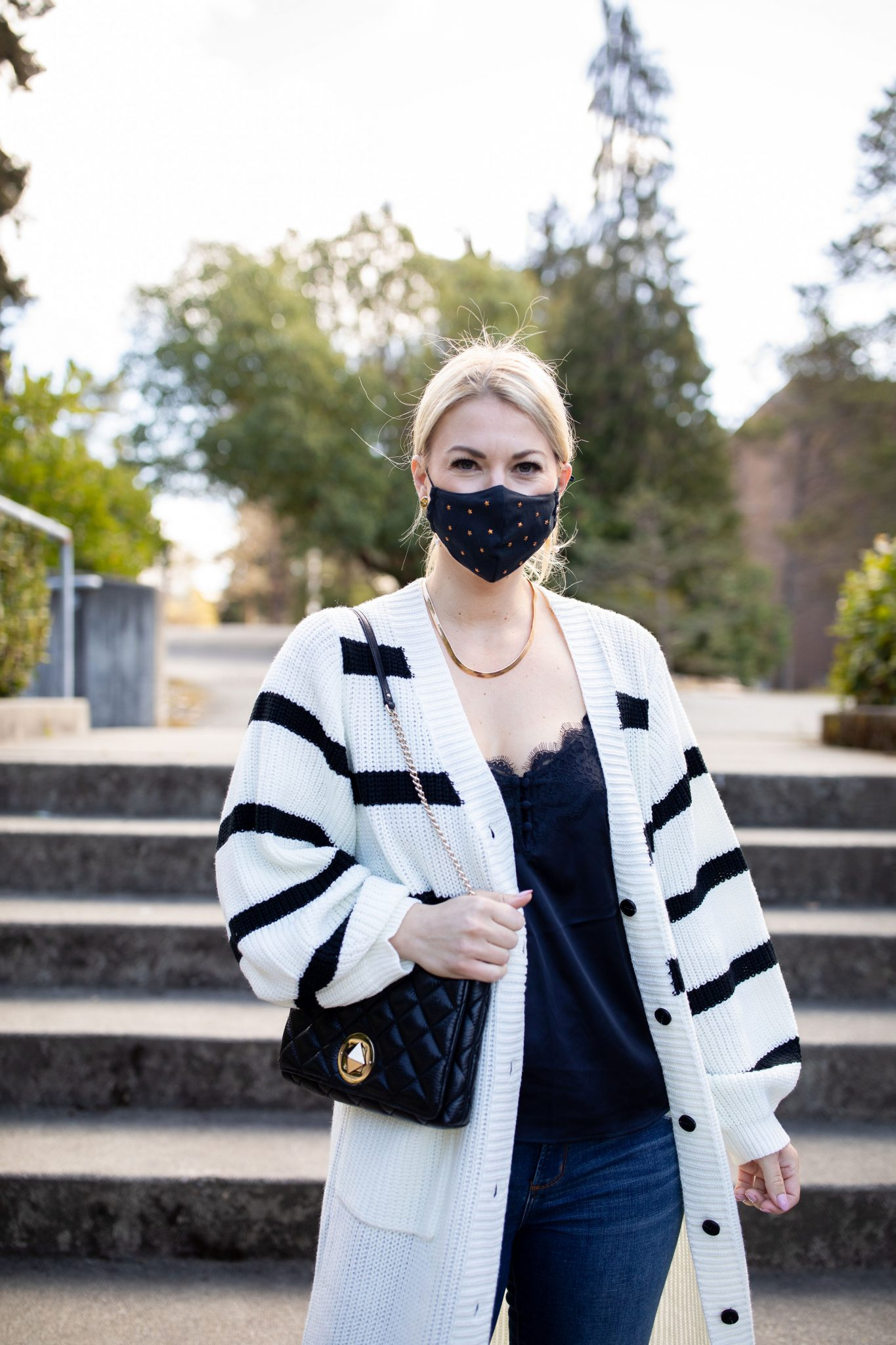 Longline Striped Cardigan by popular Seattle tall fashion blog, Whit Wanders: image of a woman wearing a black and white stripe longline cardigan with a black lace cami , black and gold star print face mask, and jeans.