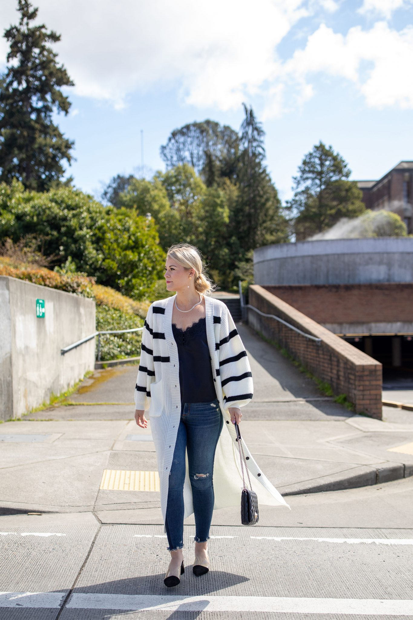 Longline Striped Cardigan by popular Seattle tall fashion blog, Whit Wanders: image of a woman wearing a black and white stripe longline cardigan with a black lace cami and jeans.